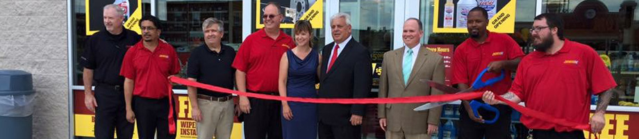 Mayor Thomas N. Micozzie participates in a ribbon cutting ceremony